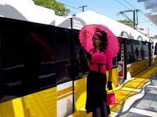 Girl boarding the Metro Expo Line