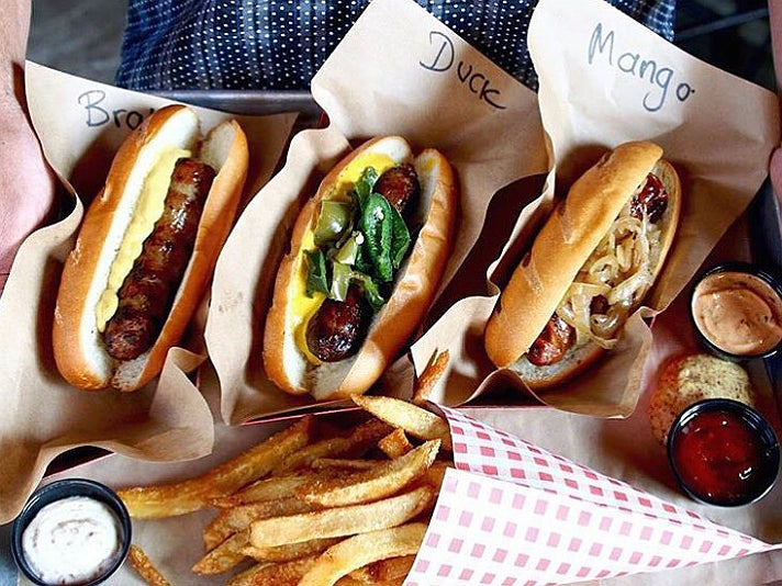 Bratwurst, duck and bacon, mango jalapeño, Belgian fries at Wurstküche